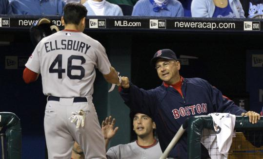 Jacoby Ellsbury gets kudos from Terry Francona after scoring during the Sox' six-run fifth.