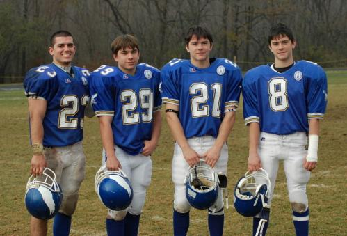 The Coppola family watched two brothers suffer similar vertebrae injuries over the past year as Brandon (8) and Jared (29) were both hurt during game action. Now the community is rallying around the North Reading family. The Coppola brothers (from left): Derek, Jared, Tyler, and Brandon taken following the team's Thanksgiving Day battle with Xaverian in November 2007. Stroll through our gallery for more photos of the brothers.