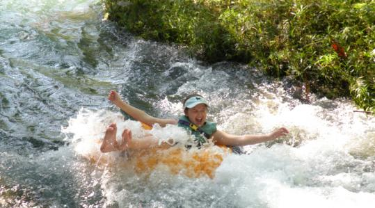 Wheee! The author&#8217;s daughter tubing in Jamaica.