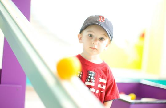 Matthew Ranger of Kingston, N.H., keeps his focus at the Children's Museum in Portland.