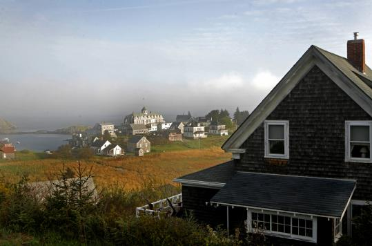 A view of the village on the harbor side of Monhegan Island; biking is big on Peaks Island..