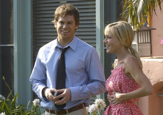 "RANDY TEPPER/SHOWTIMEMichael C. Hall is the title character and Julie Benz is Rita in Showtime's ""Dexter.''"