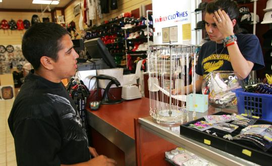 GARY KAZANJIAN/ASSOCIATED PRESSCameron Hinojosa hands a store clerk his resume last week at the Family Clothes Store in Fresno, Calif. This year, young workers have faced one of the bleakest job markets in decades.