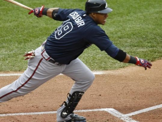 Yunel Escobar delivers a two-out, two-run single in the first inning, starting the Braves on their way to an 11-5 victory over the Nationals.