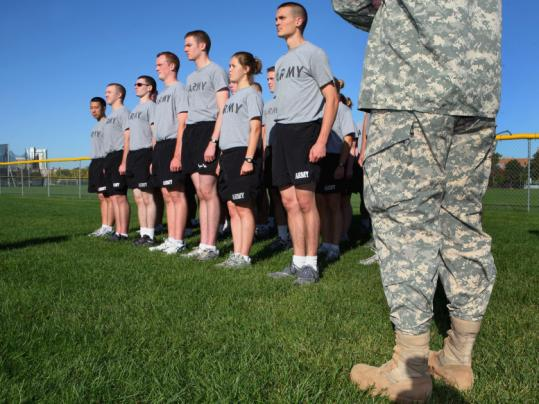 Staff Sergeant Charles Andrews led recruits through a training session yesterday at Steinbrenner Stadium in Cambridge.