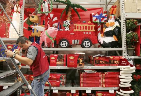 Lowe's employee Dave Lleva helped set up a towering display of Christmas decorations in Woburn last week.