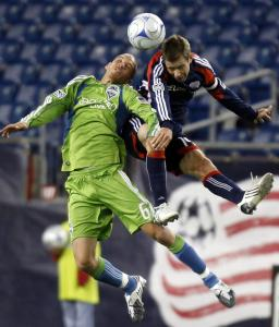Revolution captain Steve Ralston was injured battling Seattle's Osvaldo Alonso for this ball.