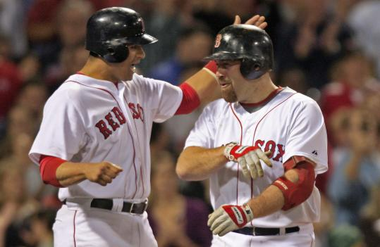 Red Sox third baseman Kevin Youkilis (right), who celebrates his first of two homers with Victor Martinez, was one of the few bright spots in an otherwise dreary night for the Red Sox.