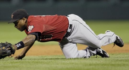Astros shortstop Miguel Tejada dove but couldn't catch up to Jayson Werth's grounder during the Phillies' win.