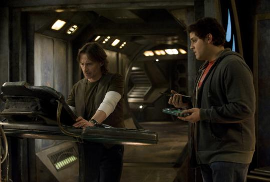 "Robert Carlyle (left) plays a single-minded scientist and David Blue portrays a super-smart kid recruited for the operation in Syfy's ""Stargate Universe.''"