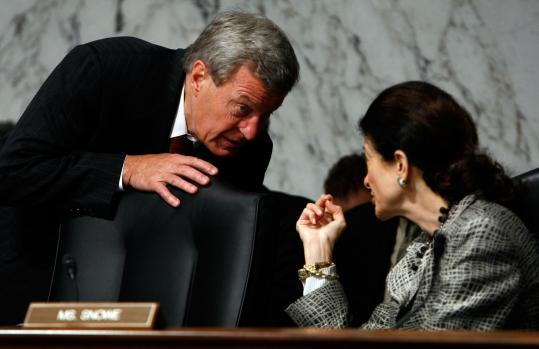 Max Baucus, chairman of the Senate Finance Committee, conferred with Senator Olympia Snowe during a hearing yesterday.