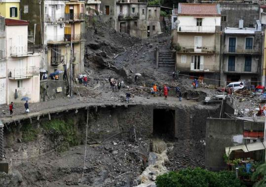 A road collapsed yesterday in the village of Molino near Messina in Sicily. Environmentalists suggested the deadly mudslides could be attributed in part to unregulated development.