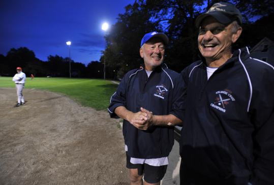 Stu Gray of Chestnut Hill (center) and Bob Clifford of Hingham reacted to a play during a recent game in Wayland. The two are taking part in a trip to Cuba for 60 members of the Eastern Massachusetts Senior Softball Association.