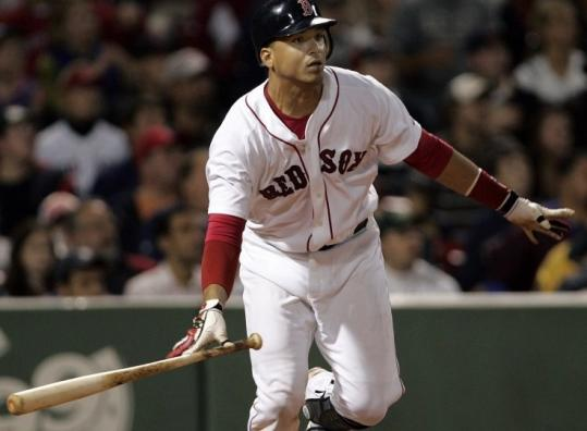 Victor Martinez follows the flight of his grand slam to right, the big blow in the Red Sox' seven-run inning.