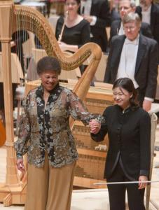 Harpist Ann Hobson Pilot (left) with assistant conductor Shi-Yeon Sung at Symphony Hall Saturday. Pilot retired last season after 40 years with the BSO and returned for a farewell.