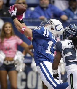 Colts rookie Austin Collie gets his mitts on a 21-yard touchdown pass from Peyton Manning.