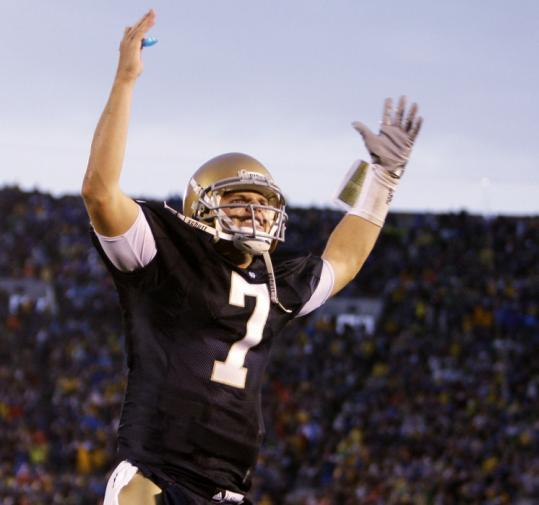Notre Dame and quarterback Jimmy Clausen got a big lift after a 2-point conversion late in the fourth against Washington.