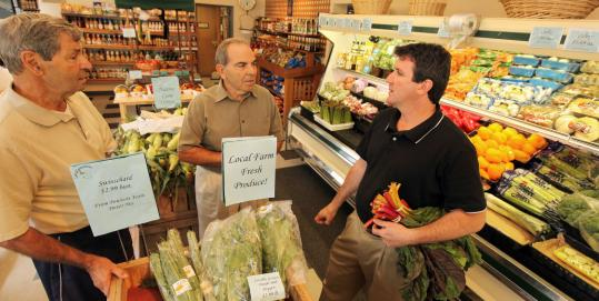From left: Francis, Robert, and Rick Ciccarelli in Tilly & Salvy's Bacon Street Farm in Natick, where the family has run a market and garden center for more than 70 years.
