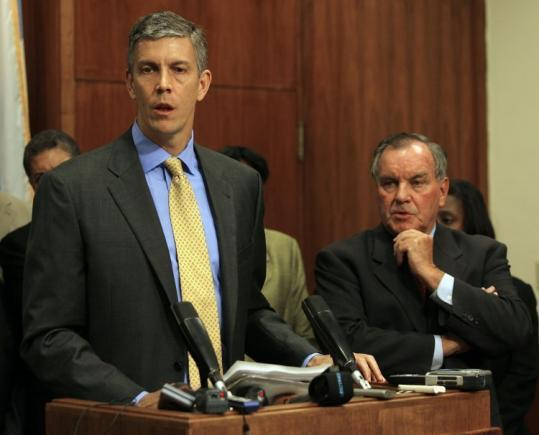 Secretary of Education Arne Duncan (left), with Chicago&#8217;s Mayor Richard Daley, also met with Fenger school families.