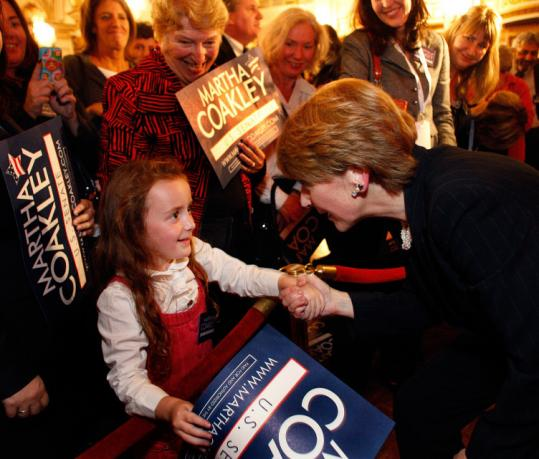 Martha Coakley greeted Sophia Wulsin, 5, of Lowell during the rally at the Fairmont Copley Plaza last night.