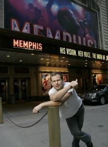 """Chad Kimball in front of the marquee for his show """"Memphis'' at the Shubert Theatre in New York City."""