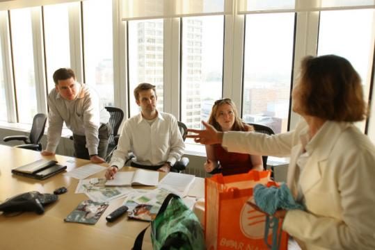 From left, ISITE Design's David Aponovich, Jeff Cram, and Margot Bloomstein meet with Ecobags CEO Sharon Rowe.