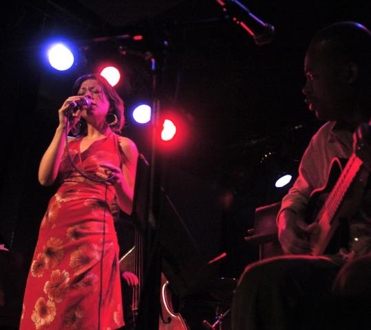 Gretchen Parlato (pictured with guitarist Lionel Loueke in 2005) sings with nuance and a great harmonic subtlety.
