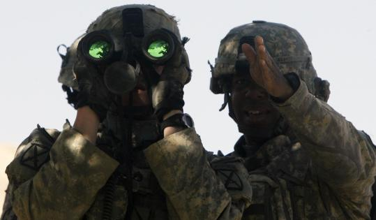 Lieutenant Gregory Avant (right) of the US Army's Able Troop, Third Squadron, 71st Cavalry, 10th Mountain Division gave directions to his observer in Logar Province, Afghanistan.