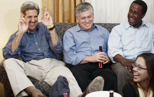 Setti Warren (right) joins several aides in a lighter moment with US Senator John Kerry during the 2004 presidential campaign.