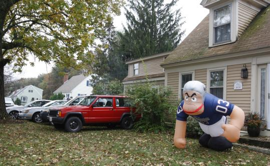 The front yard of 200 North St. in Foxborough, the only legal residential parking near Gillette Stadium, before the Patriots' game last Sunday.