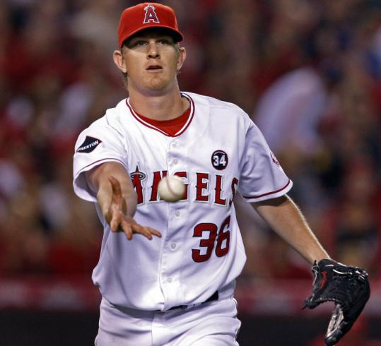Jered Weaver easily took care of this comebacker - and the entire Red Sox lineup - in Game 2 of the ALDS.
