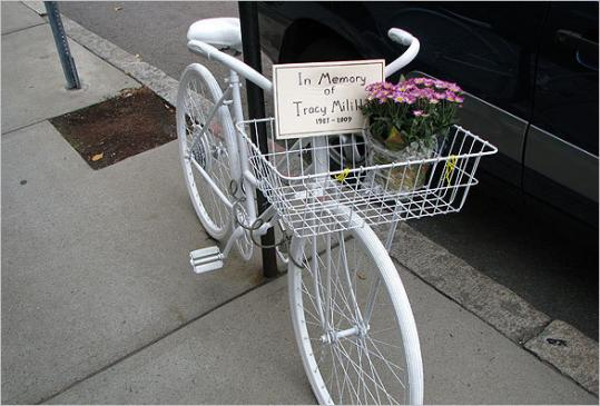 A white 'ghost bicycle 'marks the spot on Longwood Avenue in Brookline where 22-year-old Emmanuel College graduate Tracy Milillo was fatally injured last month. A motorist who stopped at the scene after thinking that he may have struck Milillo has been cleared by police.