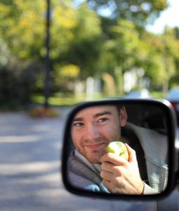 "Sam Maman, 19, a Northeastern University student from Newton, prefers pizza on his commute. ""It's hard to use the phone and the pizza and the car, though.''"