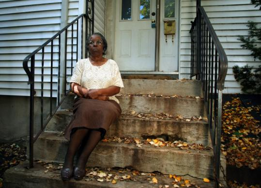 Helen Ford sat last week on the steps of the home in Cambridge in which she raised basketball star Rumeal Robinson.