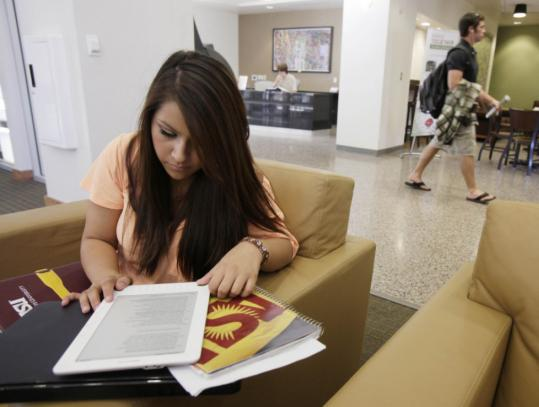 Claire Becerra, a freshman political science major at Arizona State University, uses her Kindle DX for her studies in Tempe. She misses being able to easily take notes.