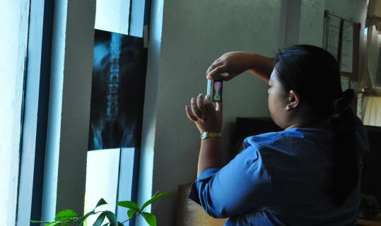 A general practitioner in Batanes, in the Philippines, uses a cellphone with Moca software to transmit an X-ray to a radiologist in Manila.