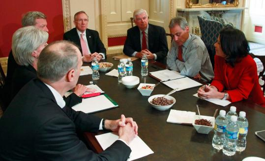 White House chief of staff Rahm Emanuel (second from right) discussed drafting a unified health care bill with officials of the legislative and executive branches during a Democratic Caucus lunch on Capitol Hill yesterday.