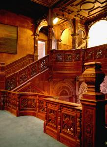 A carved oak staircase leads to the upper floor of the mansion on Dartmouth Street.