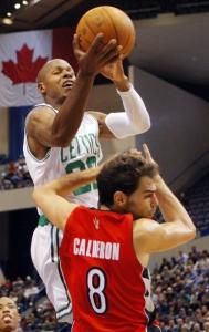 Celtics guard Ray Allen is fouled by Jose Calderon of the Raptors on a drive to the hoop last night.