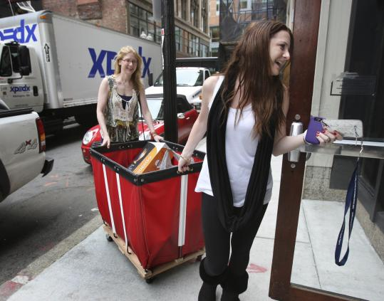 Alexandra Kaplan (right) of Los Angeles gets help from a personal concierge, Vyctoria Thwreatt, to move into her Suffolk University dorm.