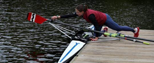 Annie Coppock, who will compete in the club singles tomorrow, makes ready before her practice run on the Charles River yesterday.