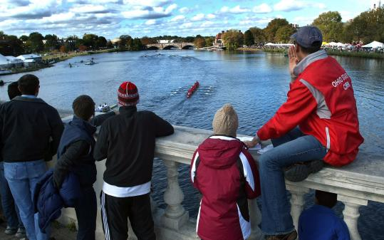 Spectators watched the men's alumni eights from Weeks footbridge. The temperature was 48 with a 17-mile-per-hour wind.