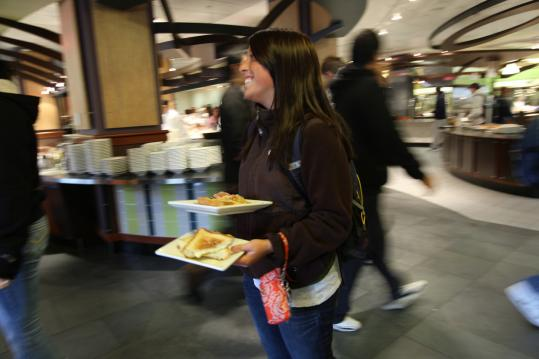 Gabriela Cerretani looked for a place to eat her smaller-portion meal in Merrimack College's dining hall.