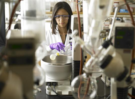 Pui Yee Ng works in Sirtris's chemistry lab. Drugs in the Cambridge biotechnology company's pipeline are aimed at treating diseases associated with aging.