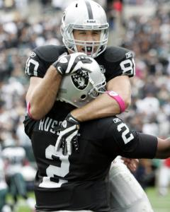 After Zach Miller scampered 86 yards for a TD, Raiders quarterback JaMarcus Russell ran downfield to give his tight end a deserving hug.