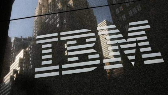 IBM placed Robert Moffat, an employee since 1978, on leave after he was charged in an insider trading scandal.