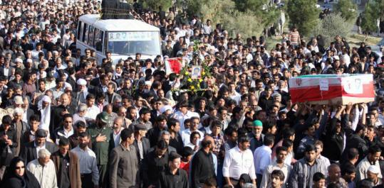 Iranians marched in the funeral procession of Iran's elite Revolutionary Guards and local tribesmen in Zahedan.