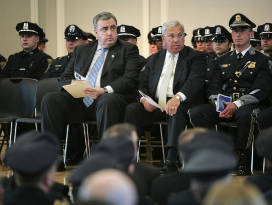 Police Commissioner Edward F. Davis and Mayor Thomas M. Menino attended a police academy ceremony in June.
