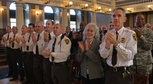 EMS workers stood and applauded for their former chief, Richard Serino, after he was sworn in as FEMA's deputy administrator yesterday at Faneuil Hall.