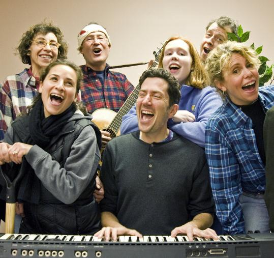 "Rene Pfister plays the piano for a rehearsal of his musical ""An American Town'' with (front, from left) Lauren Smith and Katherine Glass, and (back, from left) Jean Nigro, Peter Pease, Emily Jones, and Eric Hanselman."